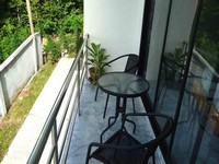 rental price studio apartment ZEN Balcony overlooking coconut plantation